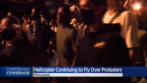 National Guard helicopter flies over area protests at request...